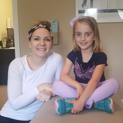 Adel Pediatric Chiropractor with Patient